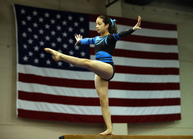 Erica Pedraza, 11, with Hopes and Dreams Gymnastics in Springdale, Ark., warms up on the balance beam during the Nadia Comaneci Invitational Sports Festival on Saturday, Feb. 16, 2013  in Oklahoma City, Okla. Photo by Steve Sisney, The Oklahoman