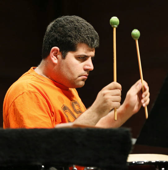 "With mallets in mid air, Stuart Langsam prepares for an entrance in Christopher Rouse's percussion ensemble piece ""Ogoun Badagris.""   Photo by Nate Billings, The Oklahoman <strong>NATE BILLINGS</strong>"