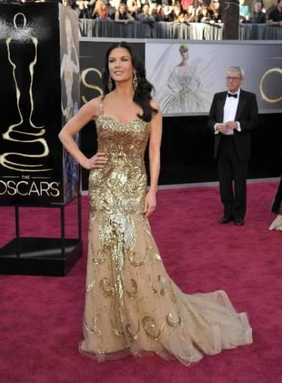 Catherine Zeta-Jones looks glam in gold on the Oscars red carpet. (AP)