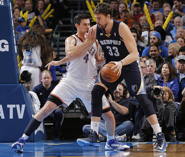Oklahoma City's Nick Collison (4) defends on Memphis' Marc Gasol (33) during the NBA basketball game between the Oklahoma City Thunder and the Memphis Grizzlies at Chesapeake Energy Arena on Wednesday, Nov. 14, 2012, in Oklahoma City, Okla.   Photo by Chris Landsberger, The Oklahoman