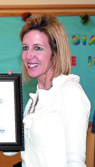 Mary Wolf, shown this year accepting a Boy Scouts of America award in honor of her son. <strong> - PHOTO PROVIDED</strong>