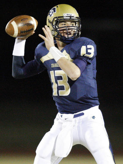 Heritage Hall's Cooper Cloud (13) passes during the high school football playoff game between Bridge Creek and Heritage Hall at Heritage Hall School in Oklahoma City, Friday, Nov. 19, 2010. Photo by Nate Billings, The Oklahoman