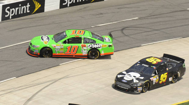 Danica Patrick (10) spins out in front of Scott Speed (95) during the STP 500 NASCAR Sprint Cup series auto race at Martinsville Speedway in Martinsville, Va., Sunday, April 7, 2013.  (AP Photo/Don Petersen)