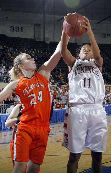 Fairview's Haley Baker (24) defends on Northeast's Danielle Gaddis (11) during the 2A girls State Basketball Championship game between Northeast High School and Fairview High School at State Fair Arena on Saturday, March 10, 2012 in Oklahoma City, Okla.  Photo by Chris Landsberger, The Oklahoman