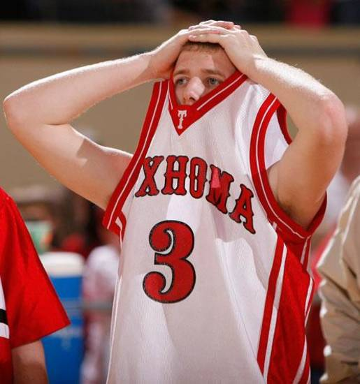 Cash Overton (3) reacts to Texhoma's loss to Preston during the boys Class A State Basketball, Saturday, March 7, 2009, at the State Fair Arena in Oklahoma City . PHOTO BY SARAH PHIPPS. THE OKLAHOMAN