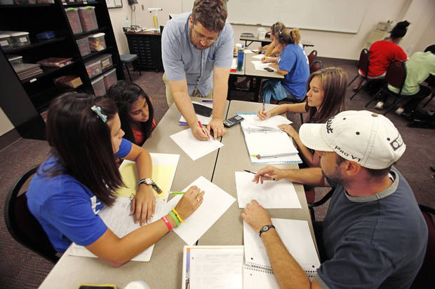 Instructor Daniel Benton works with Lauren McKenzie, Bhavini Patel, Kylie Ingram and Tripp Robertson in a math class at Oklahoma City Community College. Photos by David McDaniel, The Oklahoman