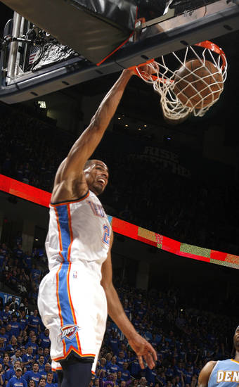 Oklahoma City's Thabo Sefolosha (2) dunks during the first round NBA basketball playoff game between the Oklahoma City Thunder and the Denver Nuggets on Wednesday, April 20, 2011, at the Oklahoma City Arena. Photo by Sarah Phipps, The Oklahoman