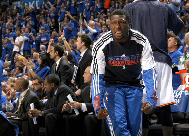 Oklahoma City's Nate Robinson (3) celebrates on the bench during the first round NBA basketball playoff game between the Oklahoma City Thunder and the Denver Nuggets on Wednesday, April 20, 2011, at the Oklahoma City Arena. Photo by Sarah Phipps, The Oklahoman