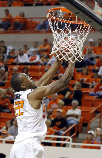 Oklahoma State's Markel Brown (22) dunks during the college basketball game between Oklahoma State University and Portland State, Sunday,Nov. 25, 2012. Photo by Sarah Phipps, The Oklahoman