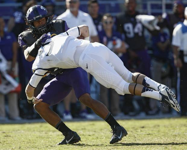 TCU linebacker Jonathan Anderson sacks West Virginia quarterback Clint Trickett in a game in Fort Worth last November. (AP Photo)