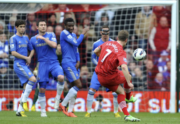 Southampton's Rickie Lambert, right,  scores his side's second goal against Chelsea during the English  Premier League match at St Mary's, Southampton England Saturday March 30, 2013.(AP Photo/ Daniel Hambury/PA) UNITED KINGDOM OUT