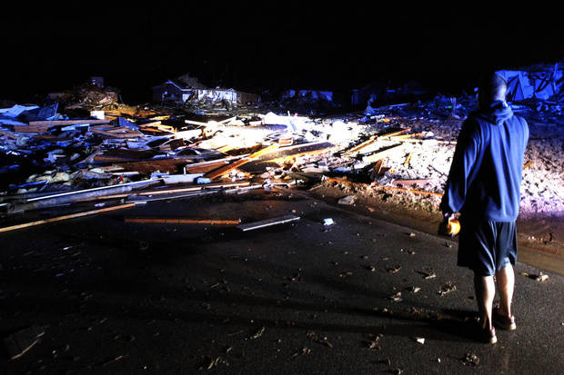 Residents walk around through the debris as a severe storm ripped through the Trussville area in the early hours of Monday, Jan. 23, 2012, in Trussville, Ala.  A storm system produced a possible tornado that moved across northern Jefferson County around 3:30 a.m., causing damage in Oak Grove, Graysville, Fultondale, Centerpoint, Clay and Trussville, according to authorities. (AP Photo/Butch Dill) ORG XMIT: ALBD103