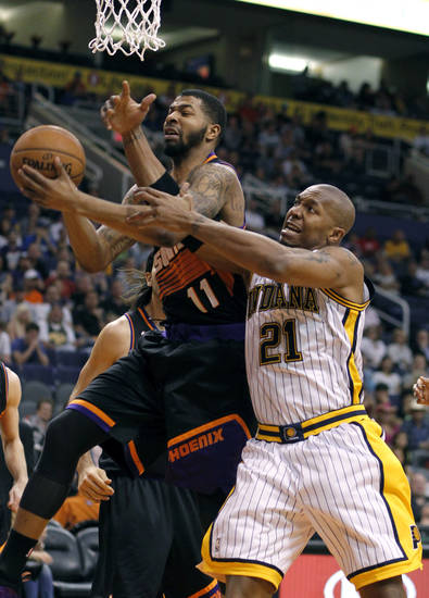 Phoenix Suns forward Markieff Morris, left, grabs a rebound in front of Indiana Pacers forward David West, right, during the first half of an NBA basketball game, Saturday, March 30, 21013, in Phoenix. (AP Photo/Paul Connors)
