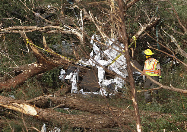 Rescue workers search the debris field where cars were swept off I-40 west of El Reno, Tuesday, May 24, 2011. Photo by Chris Landsberger, The Oklahoman ORG XMIT: KOD