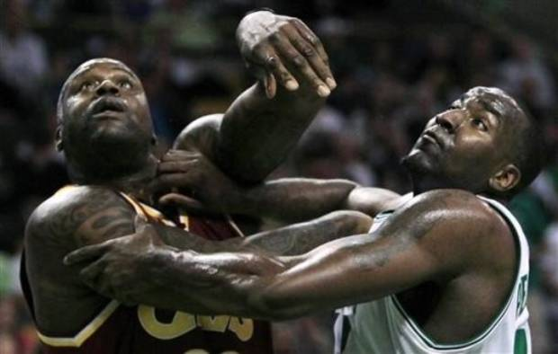 Boston Celtics center Kendrick Perkins, right, and Cleveland Cavaliers center Shaquille O'Neal, left, push off each other on a rebound during the first half of Game 4 in a second-round NBA basketball playoff series Sunday, May 9, 2010, in Boston.(AP Photo/Charles Krupa)