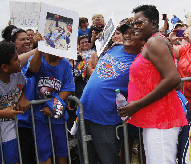 Wanda Pratt, Kevin Durant's mother, poses for a photo with Jose Romero while waiting for the team to arrive during a welcome home rally for the Oklahoma City Thunder in a field at Will Rogers World Airport after the team's loss to the Miami Heat in the NBA Finals, Friday, June 22, 2012. Photo by Nate Billings, The Oklahoman