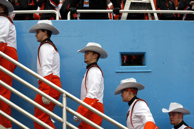 The OSU make their way to their seats before the Heart of Dallas Bowl football game between the Oklahoma State University (OSU) and Purdue University at the Cotton Bowl in Dallas,  Tuesday,Jan. 1, 2013. Photo by Sarah Phipps, The Oklahoman