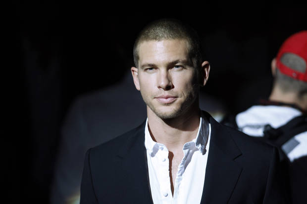 French top model Adam Senn poses prior to the Dolce & Gabbana fashion show, from the men's Spring-Summer 2013 collection, part of the Milan Fashion Week, unveiled in Milan, Italy, Saturday, June 23, 2012. (AP Photo/Luca Bruno)