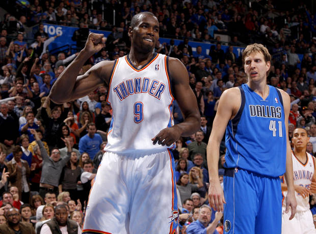 Oklahoma City&#039;s Serge Ibaka (9) reacts beside Dallas&#039; Dirk Nowitzki (41) during an NBA basketball game between the Oklahoma City Thunder and the Dallas Mavericks at Chesapeake Energy Arena in Oklahoma City, Thursday, Dec. 27, 2012.  Oklahoma City won 111-105. Photo by Bryan Terry, The Oklahoman