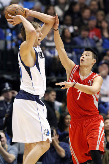 Dallas Mavericks forward Dirk Nowitzki (41) looks to pass as Houston Rockets guard Jeremy Lin (7) defends during the first half of an NBA basketball game, Wednesday, Jan. 16, 2013, in Dallas. (AP Photo/John F. Rhodes)