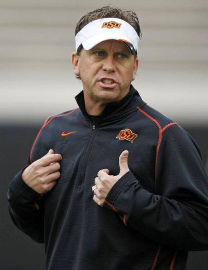OKLAHOMA STATE UNIVERSITY COLLEGE FOOTBALL: Todd Monken, OSU offensive coordinator and quarterbacks coach, during Oklahoma State spring football practice at Boone Pickens Stadium in Stillwater, Okla., Monday, March 7, 2011. Photo by Nate Billings, The Oklahoman ORG XMIT: KOD