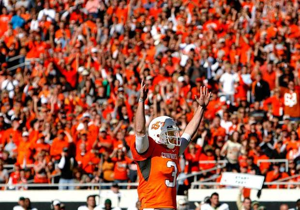 OSU's Brandon Weeden celebrates a touchdown during the college football game between the Oklahoma State University Cowboys  and the Baylor University Bears at Boone Pickens Stadium in Stillwater, Okla., Saturday, Nov. 6, 2010. Photo by Sarah Phipps, The Oklahoman