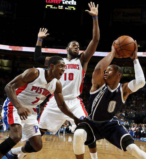 Oklahoma City's Russell Westbrook (0) works against Detroit's Greg Monroe (10) and Brandon Knight (7) during an NBA basketball game between the Detroit Pistons and the Oklahoma City Thunder at the Chesapeake Energy Arena in Oklahoma City, Friday, Nov. 9, 2012. Photo by Nate Billings, The Oklahoman
