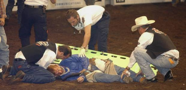 OKLAHOMA CITY, OKLA., SUNDAY 09/26/04:    INJURED, INJURY: Cord McCoy is assisted by medical personnel after falling off a horse during the PRCA Rodeo Finals at the State Fair.  He was transported to a local hospital.  Photo by Michael Downes, The Oklahoman.