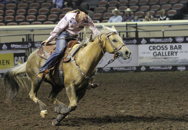 Sherry Cervi, of Marana, Ariz., competes in barrel racing during the Ram National Circuit Finals Rodeo Championship in Oklahoma City, Sunday, April 1, 2012.  Photo by Garett Fisbeck, For The Oklahoman