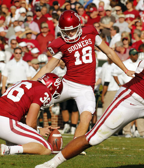 Michael Hunnicutt (18) kicks an extra point during the college football game between the University of Oklahoma Sooners (OU) and the Baylor University Bears (BU) at Gaylord Family-Oklahoma Memorial Stadium in Norman, Okla., Saturday, Nov. 10, 2012.  Photo by Steve Sisney, The Oklahoman