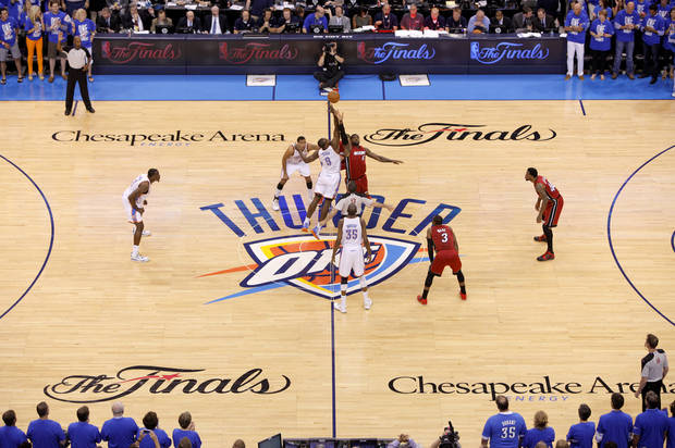 Oklahoma City's Serge Ibaka (9) and Miami's LeBron James (6) leap for the ball during the tipoff for Game 1 of the NBA Finals between the Oklahoma City Thunder and the Miami Heat at Chesapeake Energy Arena in Oklahoma City, Tuesday, June 12, 2012. Photo by Bryan Terry, The Oklahoman