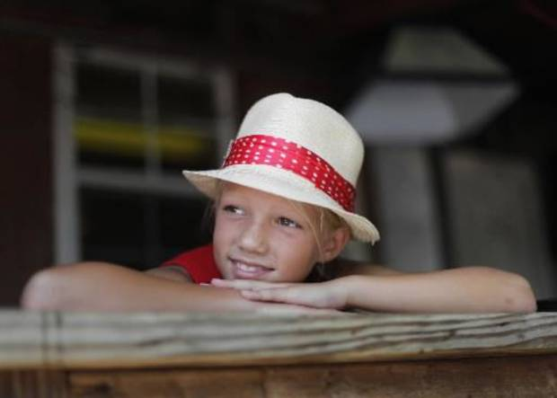 Brooke Teter, 10, of Wichita Kansas, watches a performance during the Woody Guthrie Folk Festival in Okemah, Okla., Thursday, July 12, 2012. Photo by Garett Fisbeck, The Oklahoman