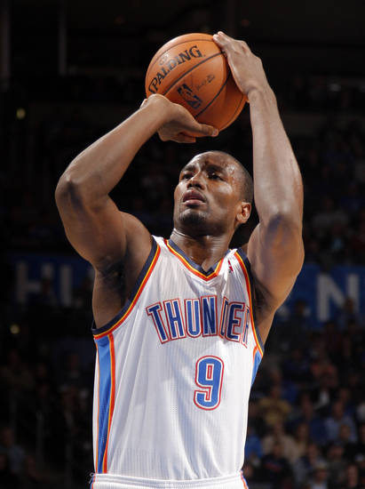 Oklahoma City's Serge Ibaka (9) shoots a free throw during the NBA basketball game between the Oklahoma City Thunder and the Cleveland Cavaliers at the Chesapeake Energy Arena, Sunday, Nov. 11, 2012. Photo by Sarah Phipps, The Oklahoman
