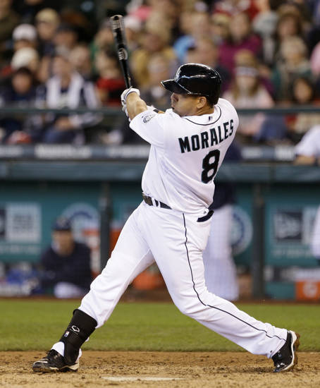 Seattle Mariners' Kendrys Morales hits a two-run home run against the Texas Rangers in the sixth inning in a baseball game Sunday, May 26, 2013, in Seattle. (AP Photo/Elaine Thompson)