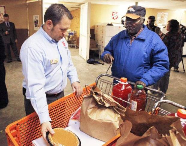 Salvation Army Director of Operations Jeff Lara helps Owens Gaddis, as seniors receivie free Thanksgiving turkeys and food at Salvation Army Social Services in Oklahoma City, OK, Tuesday, Nov. 16, 2010. By Paul Hellstern, The Oklahoman ORG XMIT: KOD