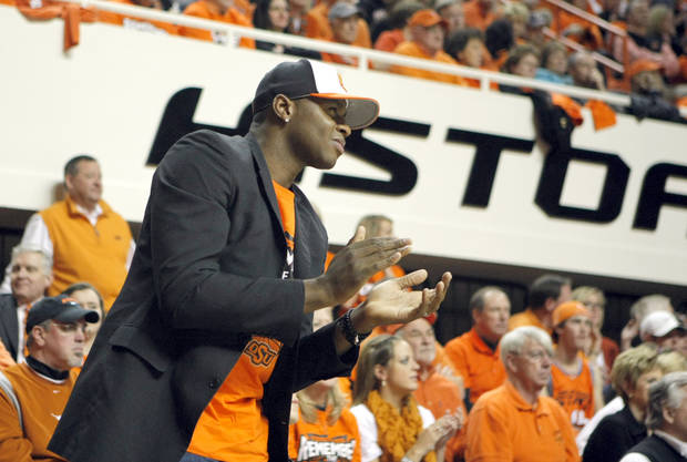 Desmond Mason cheers during the basketball game between Oklahoma State and Texas, Wednesday, Jan. 26, 2011, at Gallagher-Iba Arena in Stillwater, Okla. Photo by Sarah Phipps, The Oklahoman
