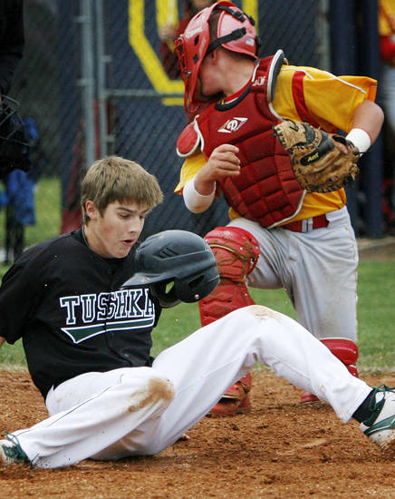 Tushka's Wyatt Daniel (11) loses his helmet while scoring in a collision at home plate with Dale catcher Ethan Sellers (7) during a Class 2A state high school baseball championship semifinal game between Dale and Tushka at Palmer Field inside Dolese Park in Oklahoma City, Friday, May 11, 2012. Photo by Nate Billings, The Oklahoman