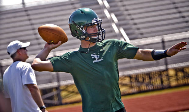 Edmond Santa Fe quarterback Justice Hansen takes to the field during the first day of football practice at Edmond Santa Fe High School on Tuesday, Aug. 7.  Photo by Chris Landsberger, The Oklahoman
