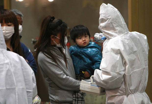 In this March 15, 2011, file photo, a child is screened for radiation exposure at a testing center in Koriyama city, Fukushima prefecture, Japan. AP file photo <strong>Wally Santana - AP file photo</strong>