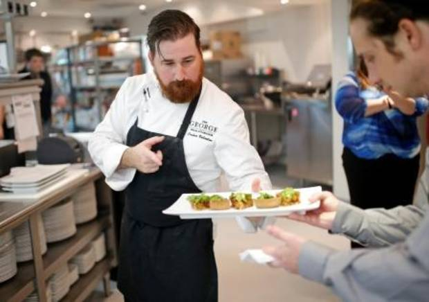 Chef Josh Valentine sends out a platter of Bacon and Onion Tarts for a private cocktail party at The George Prime Steakhouse atop Founder Tower in Oklahoma City.