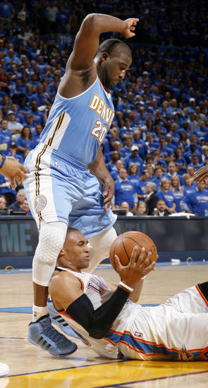 Oklahoma City's Russell Westbrook (0) slips under Denver's Raymond Felton (20) during the NBA basketball game between the Denver Nuggets and the Oklahoma City Thunder in the first round of the NBA playoffs at the Oklahoma City Arena, Sunday, April 17, 2011. Photo by Bryan Terry, The Oklahoman
