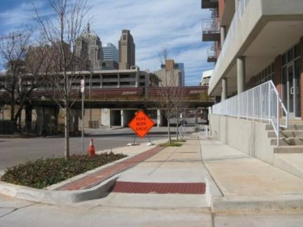 Good news, wheelchair users! Oklahoma City has provided you with a good, modern ramp onto the NE 2 sidewalk. But what's that up ahead?