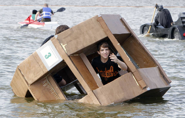 A hamster wheel designed boat goes under during the Fourth Annual Cardboard Boat Regatta at Arcadia Lake in Edmond, OK, Saturday, August 25, 2012.  By Paul Hellstern, The Oklahoman
