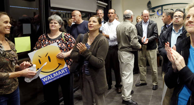 Opponents of a Walmart Neighborhood Market in northwest Edmond crowd into the lobby of the chambers where planning commissioners were meeting Wednesday. PHOTO BY BRYAN TERRY, THE OKLAHOMAN. <strong>BRYAN TERRY - THE OKLAHOMAN</strong>
