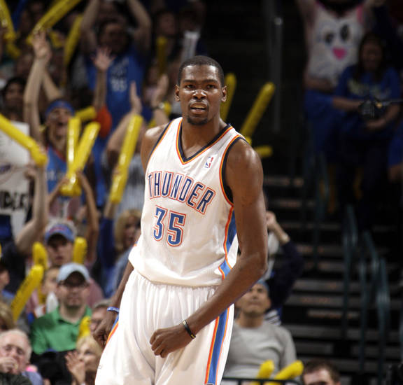 Oklahoma City's Kevin Durant (35) celebrates a Thunder score during the NBA basketball game between the Oklahoma City Thunder and the Toronto Raptors at Chesapeake Energy Arena in Oklahoma City, Sunday, April 8, 2012. Photo by Sarah Phipps, The Oklahoman.