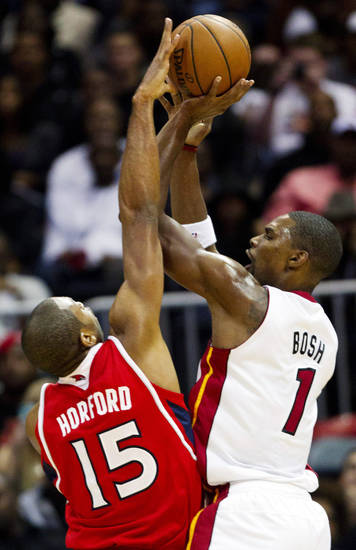 Miami Heat center Chris Bosh (1) has his shot blocked by Atlanta Hawks power forward Al Horford (15) in the first half of an NBA basketball game in Atlanta, Friday, Nov. 9, 2012. (AP Photo/John Bazemore)