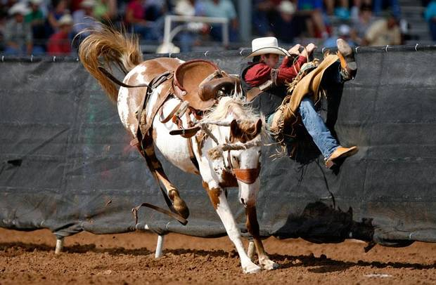Cody Carlton of Mims, Florida, gets thrown off a horse during saddle bronc at the International Finals Youth Rodeo in Shawnee, Okla. Thursday, July 16, 2009.  Photo by Ashley McKee, The Oklahoman