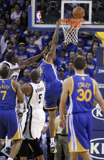 Memphis Grizzlies' Zach Randolph (50) makes contact with Golden State Warriors' Brandon Rush (4) during the first half of an NBA basketball game Friday, Nov. 2, 2012, in Oakland, Calif. Rush left the game with an injured knee after this play. (AP Photo/Ben Margot)