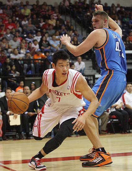 Houston Rockets' Jeremy Lin, left, drives around the baseline against Oklahoma City Thunder defender Cole Aldrich during the first quarter of an NBA preseason basketball game in Hidalgo, Texas, Wednesday, Oct. 10, 2012. (AP Photo/Delcia Lopez) ORG XMIT: TXDL108