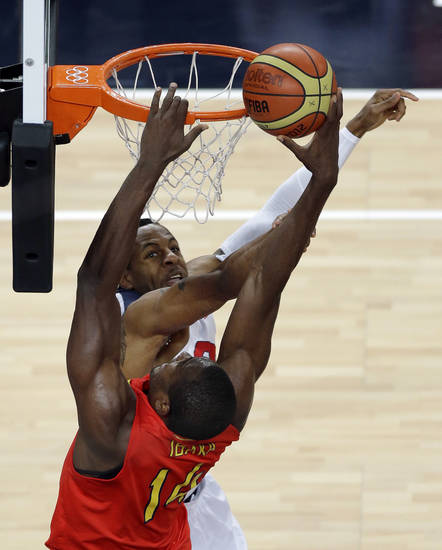 Spain's Serge Ibaka puts up a shot against  United States' Andre Iguodala during the men's gold medal basketball game at the 2012 Summer Olympics, Sunday, Aug. 12, 2012, in London. (AP Photo/Victor Caivano)